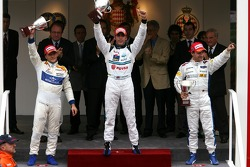 Podium: race winner Pastor Maldonado with Giorgio Pantano and Timo Glock