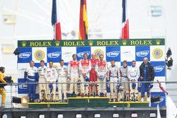 LMP1 podium: overall winners Marco Werner, Frank Biela, Emanuele pirro, second place pedro Lamy, Sté