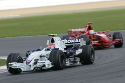 Robert Kubica, BMW Sauber F1 Team, F1.07 and Felipe Massa, Scuderia Ferrari, F2007