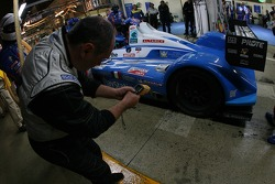 A technician takes the brake temperature on the #17 Pescarolo Sport Pescarolo Judd