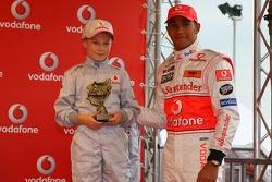 Lewis Hamilton, McLaren Mercedes, with a young karter, Vodafone Karting Event