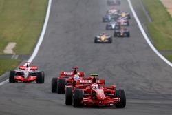 Kimi Raikkonen, Ferrari F2007; Felipe Massa, Ferrari F2007; Fernando Alonso, McLaren MP4-22