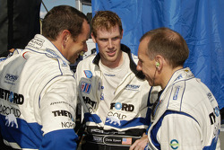 Team talk among Butch Leitzinger, Chris Dyson and Andy Wallace