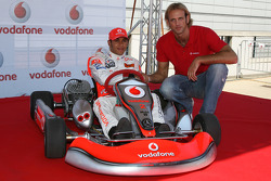 Lewis Hamilton, McLaren Mercedes with Tamas Kasas, water polo player, Vodafone Karting and opening of shop in Budapest