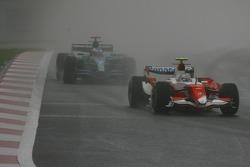 Jarno Trulli, Toyota Racing, TF107 leads Jenson Button, Honda Racing F1 Team, RA107