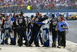 The Dupont and Lowe's crews celebrate Jeff Godon's win