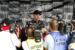 Clint Bowyer talks to the media