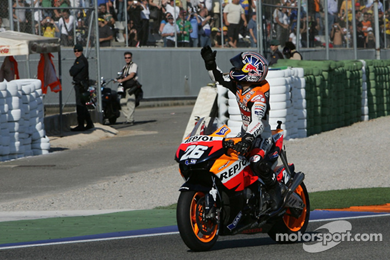 Race winner Dani Pedrosa celebrates