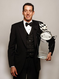Kyle Busch holds the trophy given to the fifth place driver in the NASCAR NEXTEL Cup Series standings