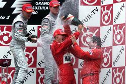 Podium: race winner and 2000 World Champion Michael Schumacher, Ferrari, second place Mika Hakkinen, McLaren, third place David Coulthard, McLaren, Jean Todt