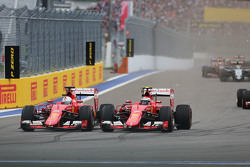 (L to R): Sebastian Vettel, Ferrari SF15-T and team mate Kimi Raikkonen, Ferrari SF15-T battle for position