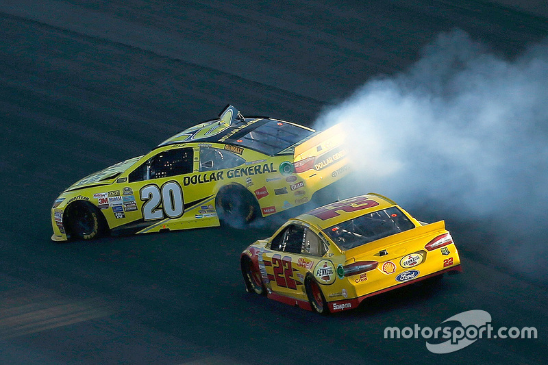 Matt Kenseth, Joe Gibbs Racing Toyota spins off the nose of Joey Logano, Team Penske Ford