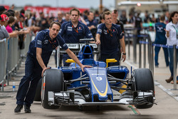 The Sauber C34 of Felipe Nasr, Sauber F1 Team is pushed by mechanics down the pit lane