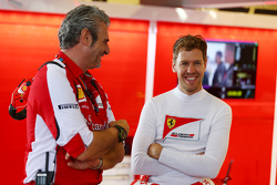 (L to R): Maurizio Arrivabene, Ferrari Team Principal with Sebastian Vettel, Ferrari