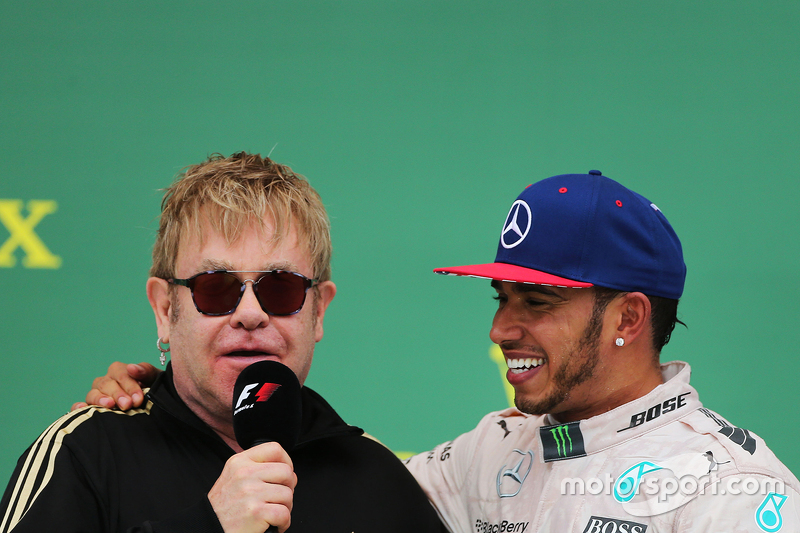 Podium: Sir Elton John with race winner and World Champion Lewis Hamilton, Mercedes AMG F1 on the podium