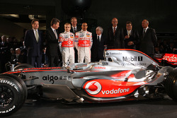 Lewis Hamilton, Heikki Kovalainen, Ron Dennis, Norbert Haug, Bernie Ecclestone and McLaren Mercedes team members pose with the new McLaren Mercedes MP4-23