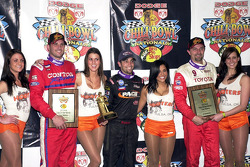 Tulsa Expo Raceway's 22nd Annual Dodge Chili Bowl Nationals winner Damion Gardner (center) is joined by runner-up Dave Darland (right) and third-place finisher Shane Cottle (left)
