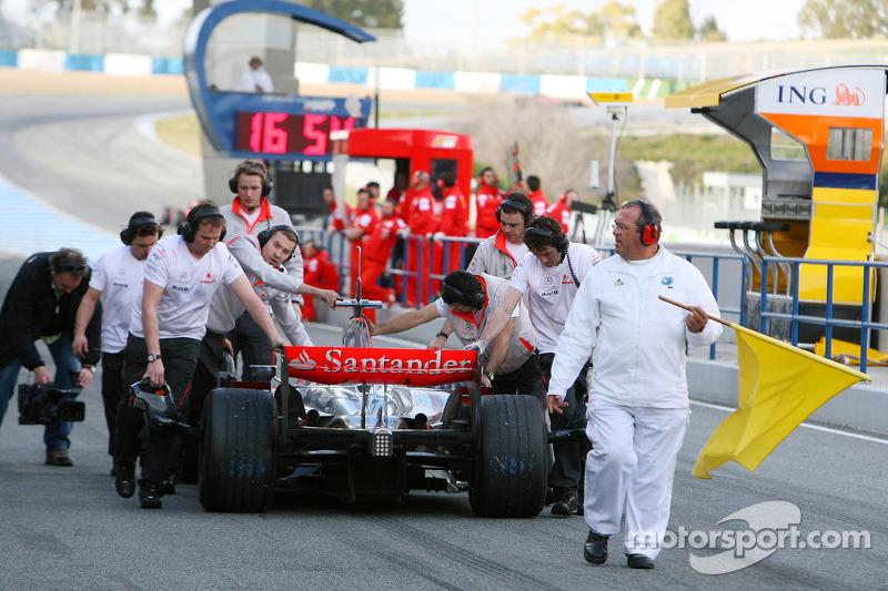 Heikki Kovalainen, McLaren Mercedes, MP4-23, stops at the pit exit