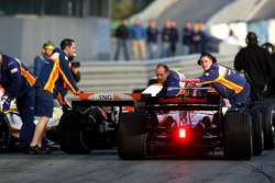 Cars wait for lights to change, end, pitlane