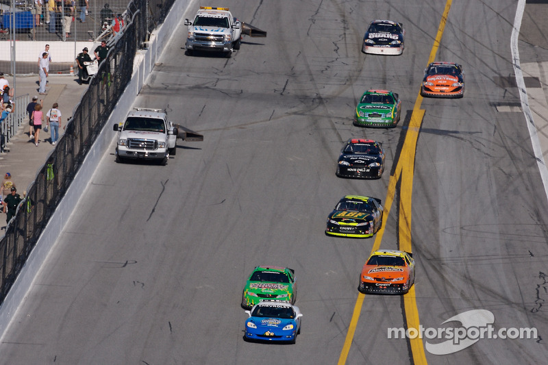 Kyle Busch leads the field behind the pace car