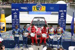 Podium: winners Sébastien Loeb and Daniel Elena, second place Chris Atkinson and Stéphane Prévot, third place Jari-Matti Latvala and Miikka Anttila