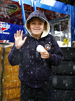 A rare snow event halts the mornings activities at Atlanta Motor Speedway as a young fan waits to strike with his snowball in hand