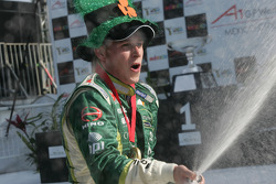 Adam Carroll, driver of A1 Team Ireland celebrates his feature race win