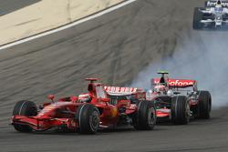Kimi Raikkonen, Scuderia Ferrari, F2008 and Heikki Kovalainen, McLaren Mercedes, MP4-23