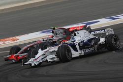 Nick Heidfeld, BMW Sauber F1 Team, F1.08 and Heikki Kovalainen, McLaren Mercedes, MP4-23