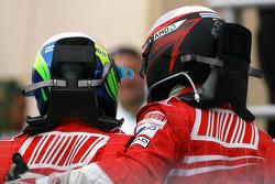 Race winner Felipe Massa celebrates with Kimi Raikkonen