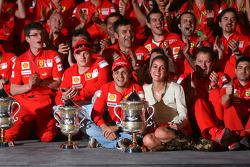 Race winner Felipe Massa celebrates with his wife Rafaela, teammate Kimi Raikkonen,  Stefano Domenicali and Scuderia Ferrari team members