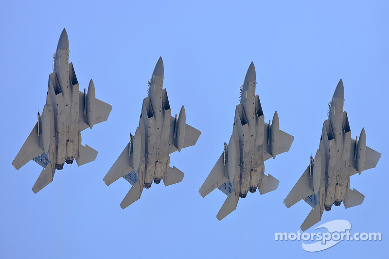 A group of F-15 Strike Eagle Fighters perform a flyover