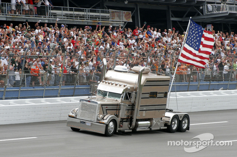 During the National Anthem a NASCAR Semi-trailer holds the American flag