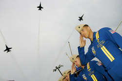 The Blue Angles fly over the Richmond International Speedway during the National Anthem