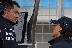 Robert Kubica,  BMW Sauber F1 Team with an engineer on the pitwall