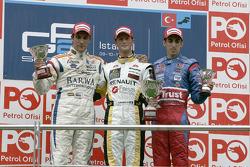 Romain Grosjean celebrates on the podium with Vitaly Petrov and Sebastien Buemi