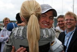 Cora Schumacher, wife of Ralf Schumacher, gives her husband a hug just before the start of the race