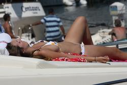 A girl sunbathing on a boat