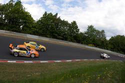 #8 Aston Martin V8 Vantage N24: Mathew Marsh, Shinichi Katsura, #23 Manthey Racing Porsche 911 GT3-MR: Armin Hahne, Christian Haarmann, Jochen Krumbach, Pierre Kaffer