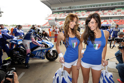 The lovely Yamaha girls pose as Valentino Rossi prepares for practice