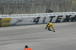 Safety workers clean the track after Dan Wheldon's accident