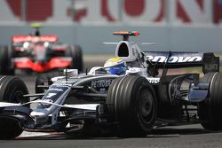 Nico Rosberg, WilliamsF1 Team, FW30 leads Heikki Kovalainen, McLaren Mercedes, MP4-23