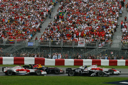 Timo Glock, Toyota F1 Team, TF108 and Kazuki Nakajima, Williams F1 Team, FW30