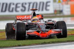 Lewis Hamilton, McLaren Mercedes, MP4-23 on the grass