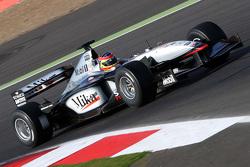 Zak Brown in een klassieke McLaren