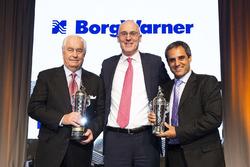 Roger Penske, James Verrier, CEO of BorgWarner and Juan Pablo Montoya with Baby Borg trophies