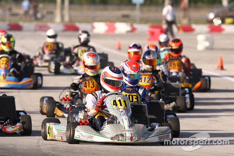 Rubens Barrichello leads the ROK Shifter field into turn 2