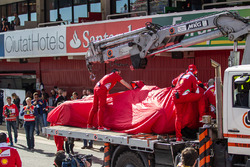 The Ferrari SF16-H of Kimi Raikkonen, Ferrari is recovered back to the pits on the back of a truck