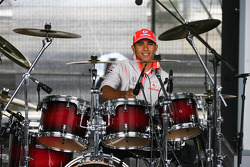 Lewis Hamilton, McLaren Mercedes playing the drums