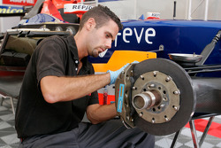 A Racing Engineering mechanic works on the car